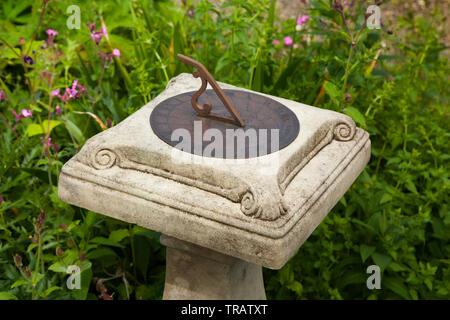 Garden sun dial on a column. - Stock Image