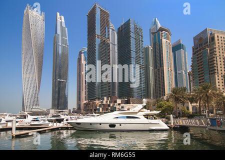 Dubai, United Arab Emirates - September 8, 2018: Yachts and buildings of Dubai Marina seen from the Dubai Marina Walk, Dubai, United Arab Emirates. - Stock Image