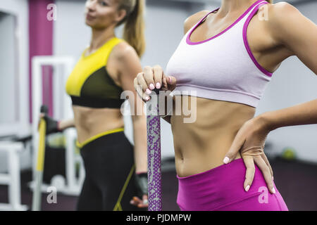 Woman wearing cropped sports top with hand on hip - Stock Image