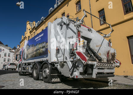 Alesund, Norway, July 27, 2018: Garbage truck is seen on the streets in town center. - Stock Image