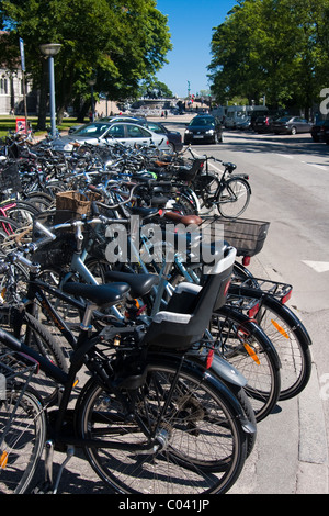 Row of bicycles parked in Copenhagen, Denmark. - Stock Image