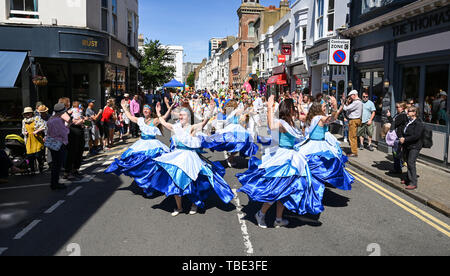 Brighton UK 1st June 2019 - Thousands of people enjoy the Kemptown Carnival parade in Brighton on a beautiful hot sunny day with temperatures expected to reach into the high twenties in some parts of the South East. Thousands are expected to attend the annual carnival in the city after a gap of two years with live music , food stalls and activities taking place throughout the day until ten in the evening . Credit : Simon Dack / Alamy Live News - Stock Image
