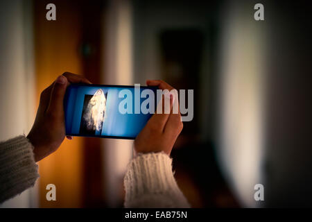 Girl takes picture of ghost. - Stock Image