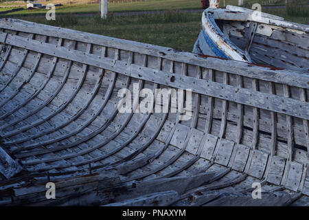A close up view of the inside of the hull of an old wooden boat showing the construction and shape of the hull's form - Stock Image