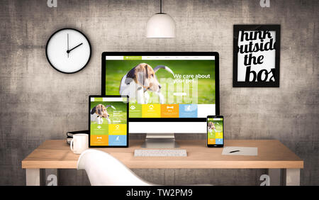 digital generated workplace desktop with  digital tablet, computer, laptop and various office objects pet website on screen. All screen graphics are m - Stock Image