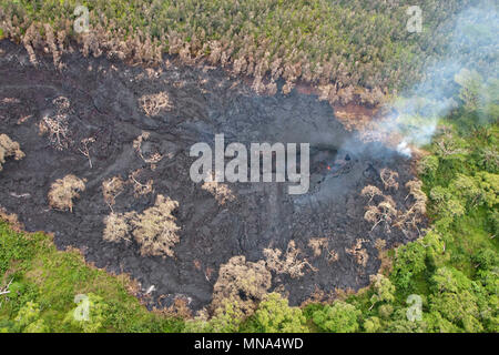 Aerial view of fissure 16 spewing lava and poison gases caused by the Kilauea volcano eruption at Leilani Estates May 12, 2018 in Pahoa, Hawaii. The recent eruption continues destroying homes, forcing evacuations and spewing lava and poison gas on the Big Island of Hawaii. - Stock Image
