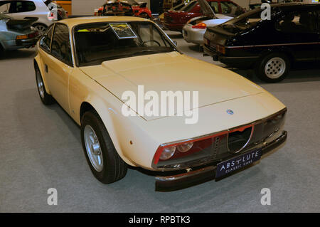 Three-quarters front view of a 1970, Alfa Romeo Junior Zagato 1300, on display on the Absolute Classic Car Stand, at the 2019 London Classic Car Show - Stock Image