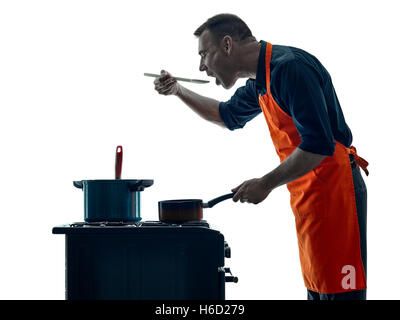 one caucasian man cooking chef silhouette isolated on white background - Stock Image