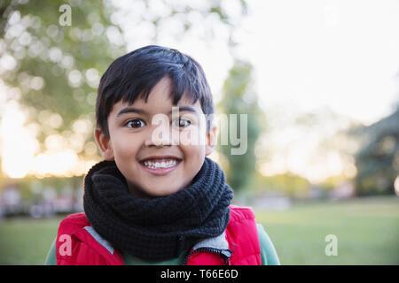 Portrait enthusiastic, cute boy in park - Stock Image