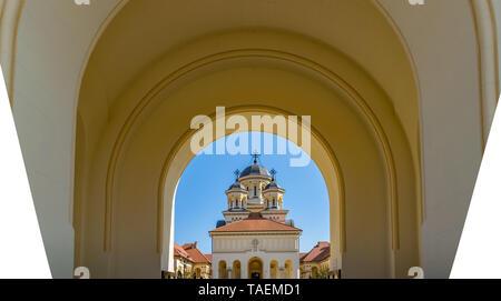 Beautiful view to the Coronation Reunification Cathedral in Alba Iulia city, Romania. A church a sunny day in Alba Iulia, Romania. - Stock Image
