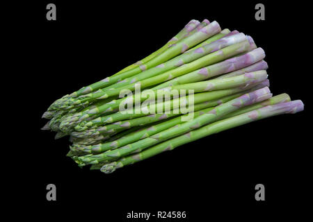 Asparagus on black background. - Stock Image