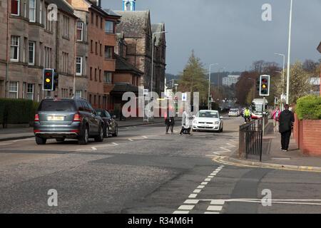 Pedestrians on a zebra crossing in a suburb of Edinburgh - Stock Image