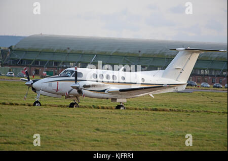 USN Beechcraft Huron Aircraft on a brief stopover visit to RAF Lossiemouth Scotland in November 2017. - Stock Image