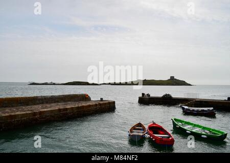 Red Boat, Green Boat and White Boat waiting at Dalkey Harbour, Dublin - Stock Image