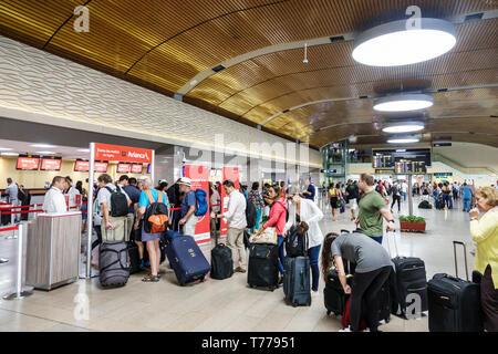 Cartagena Colombia Aeropuerto Internacional Rafael Nunez International Airport CTG terminal Hispanic resident residents man woman departing line queue - Stock Image