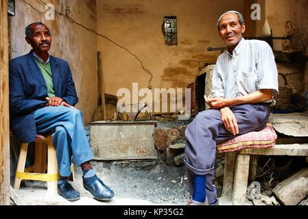 Two senior men relaxing in the medina of Fez, Morocco - Stock Image