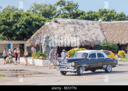 Tourists enjoy a break at a small Cuban restaurant on the outskirts of Havana. - Stock Image