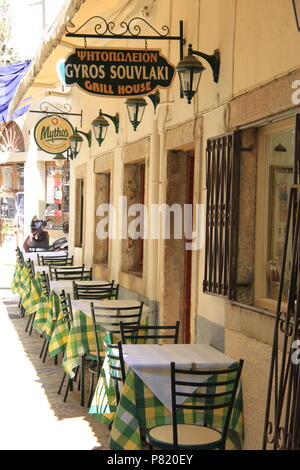 View down a side street of restaurants waiting to serve local customers Greek speciality 'gyros souvlaki' in Corfu Town, Corfu, GREECE, PETER GRANT - Stock Image