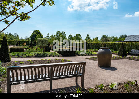 The cottage garden at RHS Hyde Hall  in Essex.Displaying some formal topiary and hedging. - Stock Image