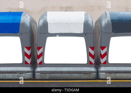Three bins with blank labels for the separate collection of glass, paper and aluminum in the street - Stock Image