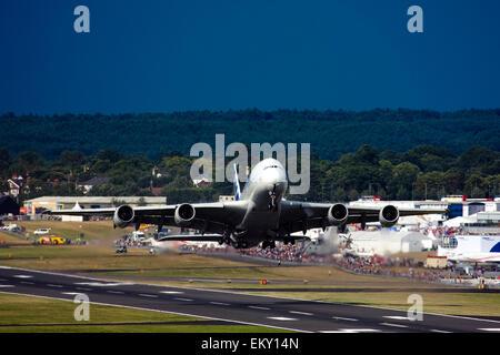 Airbus A380 taking off at Farnborough International Airshow 2015 - Stock Image