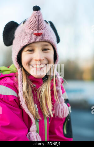 Young girl wearing funny cap - Stock Image