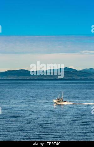 September 17, 2018 - Tongass Narrows, AK: Small aluminum hulled fishing boat speeding through ocean, early morning, north of Ketchikan. - Stock Image