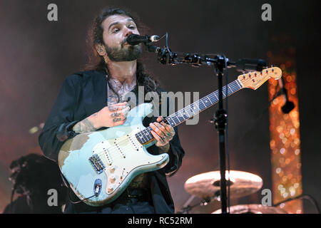 Simon Neil of Biffy Clyro onstage playing a worn Fender Stratocaster at a music festival. Stratocaster guitar, Fender Strat, Biffy Clyro lead singer. - Stock Image