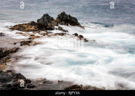 Rough seas swirling around rocks on the east coast of Tenerife, Canary Islands, Spain - Stock Image