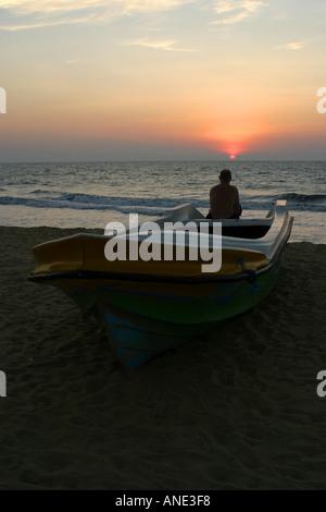 Sunset over the sea Negombo beach Sri Lanka - Stock Image