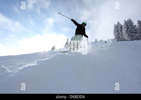 Skier going downhill - Stock Image