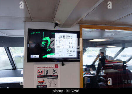 Navigation system and radar, with the Captain in the background on a boat on Milford Sound, New Zealand - Stock Image