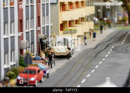 Miniature model of people pulling a piano up a tall building, at Kolejkowo, Wrocław, Wroclaw, Wroklaw, Poland - Stock Image