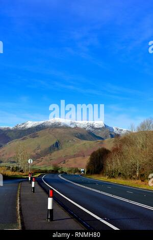 The main A66 road to the Lake District,Cumbria England, UK - with snow capped Blencathra mountain visible in the distance. - Stock Image
