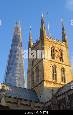 Southwark Cathedral in the foreground with The Shard to the rear by Cathedral Street, London - Stock Image
