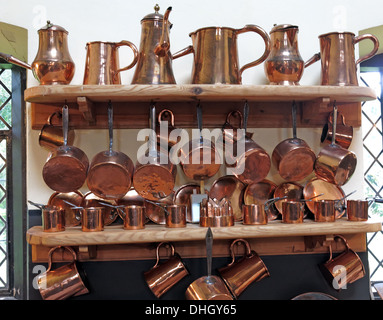 Copper wear in the kitchens at Dunham Massey NT property Cheshire England UK - Stock Image