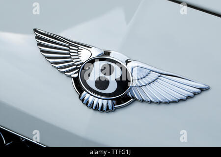 Monte-Carlo, Monaco - June 16 2019: Famous Bentley Winged 'B' Logo (Emblem) On The Bonnet Of A Luxury British White Car At Monte-Carlo, Monaco. Close - Stock Image