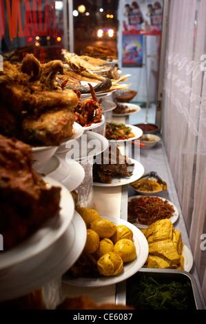 Indonesian food displayed in window of shop in Ubud, Bali - Stock Image