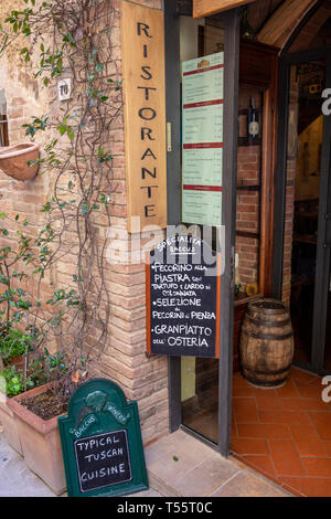 Traditional italian restaurant entrance in the village of Pienza, Tuscany,Italy - Stock Image