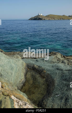 Coastal View on the Island of Kea ( Tzia ) with Lighthouse in the distance, Aegean Sea's Cyclades archipelago, Greece. - Stock Image