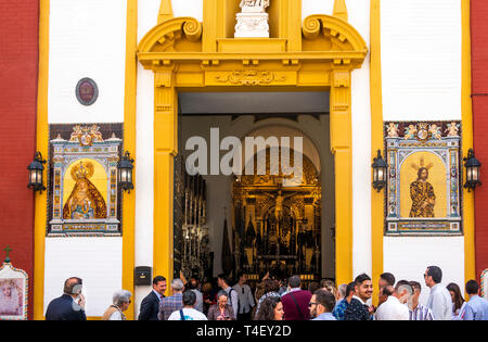 People waiting outside a church in Seville - Stock Image