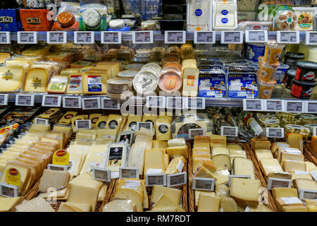 A range of cheese on display in shop in grocery store in Vienna, Austria - Stock Image