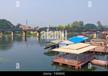 Houses, with Death Railway Bridge in the background, Mae Nam Khwae Yai, Kwai river, Kanchanaburi, Thailand - Stock Image
