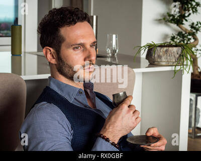 Man Drinking from Metal Cup an Espresso Coffee - Stock Image
