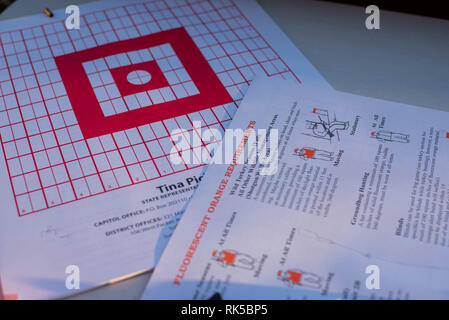 Targets and bullets from a 22 caliber rifle sit out om table during a gun safety lesson in Pennsylvania, United States - Stock Image