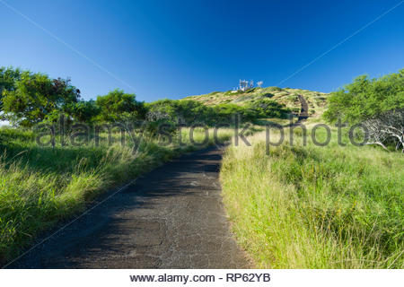 People walking down access road from the summit of Koko Head, Koko Head District Park, Hawaii Kai, Oahu, Hawaii, USA - Stock Image