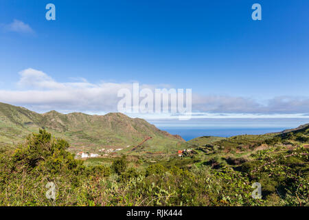 Looking down over the El Palmar valley and a hill dug out for topsoil, Teno, Tenerife, Canary Islands, Spain - Stock Image