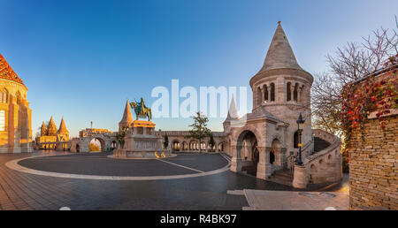 Budapest, Hungary - Panoramic view of the Fisherman's Bastion (Halaszbastya) at sunrise with autumn foliage and clear blue sky - Stock Image