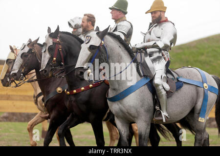 Four Knights in full Armour demonstrating their  Horse riding skills, during an  English Heritage Jousting Tournament at Dover Castle,  August 201 - Stock Image