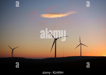 Scotland, UK. 18th Nov 2018. Sunset at Kelburn Wind Farm, near Largs in North Ayrshire, after a beautiful cloud free winters day Credit: PictureScotland/Alamy Live News - Stock Image